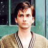 bluesuit_handy: Andrew in a beige robe, looking off to the side (.misc | robe)