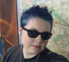 faceless_wonder: posing with my blue hair, in an NYC subway station. (emo)