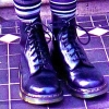 treiza: Photograph of doc marten boots worn with stripy socks. (Boots)