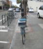 zirconium: of blue bicycle in front of Blue Bicycle Books, Charleston (blue bicycle rear)