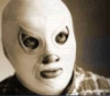 el_enmascarado_de_plata: Closeup of Santo in a silver full face Spandex mask and sequined cape (closeup on the face with cape (b&w))
