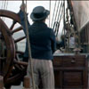 sharpiefan: Rear view of a sailor standing at the ship's wheel (At the wheel)