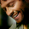 kairia: Castiel, a character from Supernatural, smiling with his eyes closed (Castiel - bent and broken)