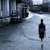 sheepfairy: tamara is walking away from the camera deeper into new cap city (caprica - the city is at war)
