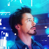 iamshadow: Still from Iron Man 2 of Tony Stark surrounded by holographic light (Wonder)