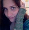 ofearthandstars: A photo of my face, resting on my hand (wearing armwarmers) (Default)