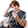 piranha: young man knitting, scratching his head, confused (knitting)