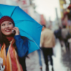 raine: (woman in rain chatting on phone)