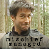 "em_kellesvig: John Sheppard looking mischievous with caption ""Mischief Managed"" (Default)"