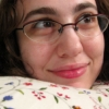 notemily: Photo of me, a white girl in her mid-20s, wearing glasses, smiling, looking up and to the right (hp - blue luna)