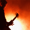 copykween: (TJR live - silhouette w/bass orange b/g)