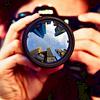 gonergone: (cityscape: reflected in camera)