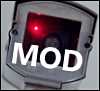 the_machine_mod: Security camera with red light. Caption: MOD. (MOD COMMENT)