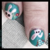 thedivinegoat: Photo of two finger nails, decorated in a light blue green, with white bunnies painted on them. (My Photo - Easter Nails)