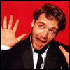 mayhap: Russell Crowe throws up his hands goofily (*flails*)