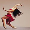 lireavue: A woman in red in a classic ballet pose. (grace and strength)