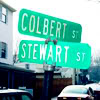 "fenellaevangela: Two street signs, one that reads ""Stewart"" and the other ""Colbert"". (Stewart Colbert)"