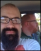 wheelieterp: a self-snapped picture of me in the car, RRC driving in the background.  ()