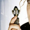 marusarel: a picture of a female hand holding a sonic screwdriver with a big of the face on the right side of the picture (Incarnations: Companion)