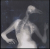 smw: An x-ray image of a woman, arms raised, with a bird's head and neck. (Metamorphosis)