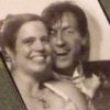 figment: A photobooth picture of me + spouse from our wedding (happy)