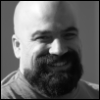 wheelieterp: Head shot of me: black and white. Shaved head. Black, full goatee. Big toothy smile. (Default)