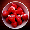 shopfront: Source: non-specified. Bowl of strawberries. Text: eat me. (Food - mmm strawberries for dessert)