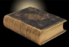 virtualvoyages: an old worn book on a black back ground, a glow at one corner of the book (glowing book)
