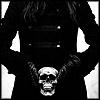 klgaffney: A long-haired, black-clothed figure holding a skull in gloved hands. (1st: ilum mušītim)