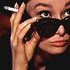 staypositive: (audrey looking over glasses)