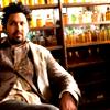 zanzando: Yusuf sitting in a chair. (Chemist of Awesome)