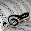 angrboda: A treble clef symbol on a sheet of music (Music)