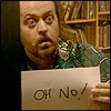 "travelingmonkey: Black Books; Manny holding ""oh no"" sign (blackbooks_ohno)"