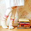 snottygrrl: girl standing by books (books and toes by the_muppet)