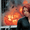 pearwaldorf: black widow with explosions behind her (avengers - black widow explosions)