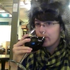 adiva_calandia: Me, drinking wine in a coffeeshop, wearing a hipster scarf, wearing a fuzzy hat with wolf/cat ears. (Left Coast girl)