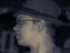 hollymath: Black and white picture of my face in profile. I'm wearing a trilby (Default)