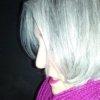 darkemeralds: DarkEm self portrait in magenta cowl, left profile, against a black wall (Silver Magenta)
