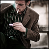 distractionary: Man reaching into jacket pocket for matches to light cigarette. (twenty minutes till the last call)