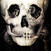 larxene: a painting of a skull with two figures creating the eye sockets (vanity)
