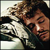 mokie: Sleepy hobbit Will Graham naps on a couch (tired, exanimate, drained, exhausted, sleepy)