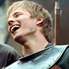 dubhartach: Arthur in armour, head thrown back, big grin (arthur grin)