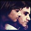 red_eft: El and Peter from White Collar. El leans over Peter's shoulder (Burke cuddles)