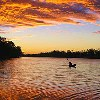 samvara: Photo of a sunset over a lake with a kayaker on it (Sport - Paddling)
