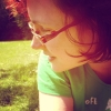 tajasel: photo of me lay in the grass, warm light. (summer)