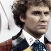 st_aurafina: The Sixth Doctor, head and shoulders, in the console room (DW: Six)