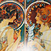 nightbird: Mucha illustration, two women facing each other (collaborators)