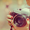 barefootsong: Hands holding a camera. (camera)