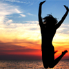 barefootsong: Silhouette of someone jumping against a sunset sky. (jump)