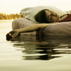 sloth: girl napping on a sofa floating in the water (water livin')